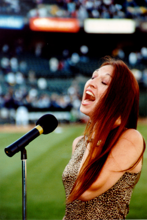 Kimberlee performs for stadium crowd of 41,000 people.